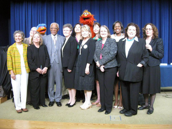 Champions of Change group photo with Muppet